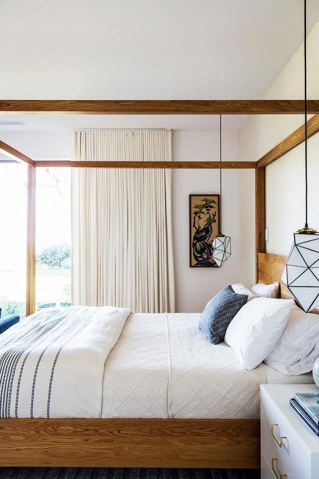 Bedroom With A Birch Canopy Bed And Low Hanging Pendant Lights Bedroomfurnitureideas