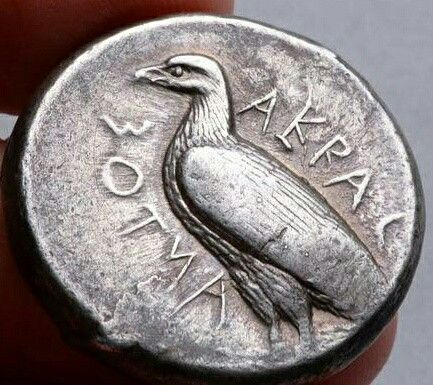 Greek silver tetradrachm from Akragas, Sicily, circa 465BCE, showing a sea eagle surrounded by the inscription Of Akragas