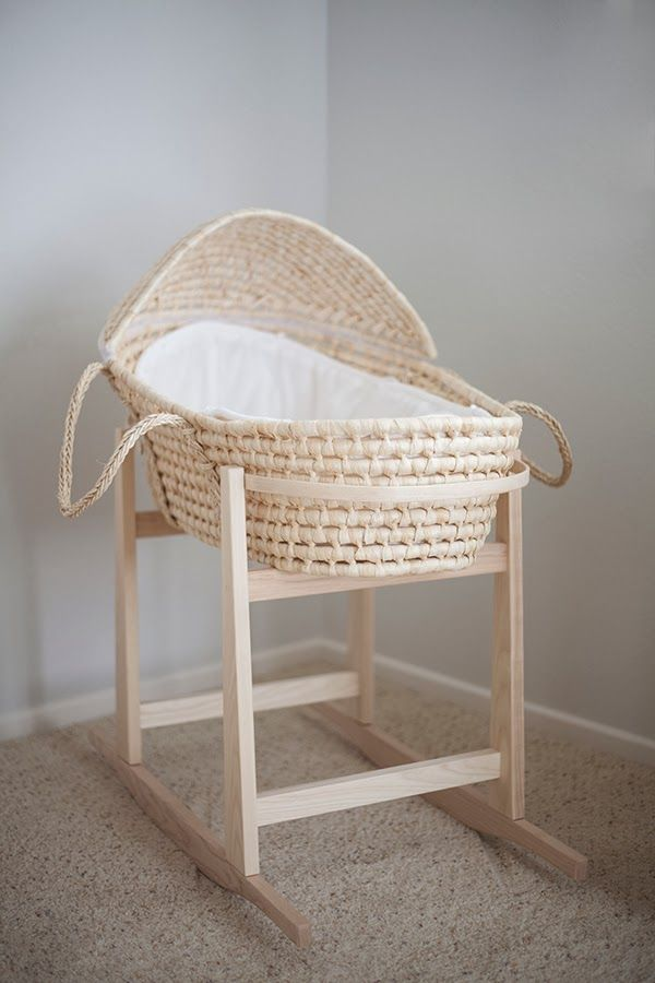 I thought it would be cute to have a bassinet with the dress hanging from the side! We could just get a small table, put a basket on it and cover the sides with fabric to make it look like a bassinet.