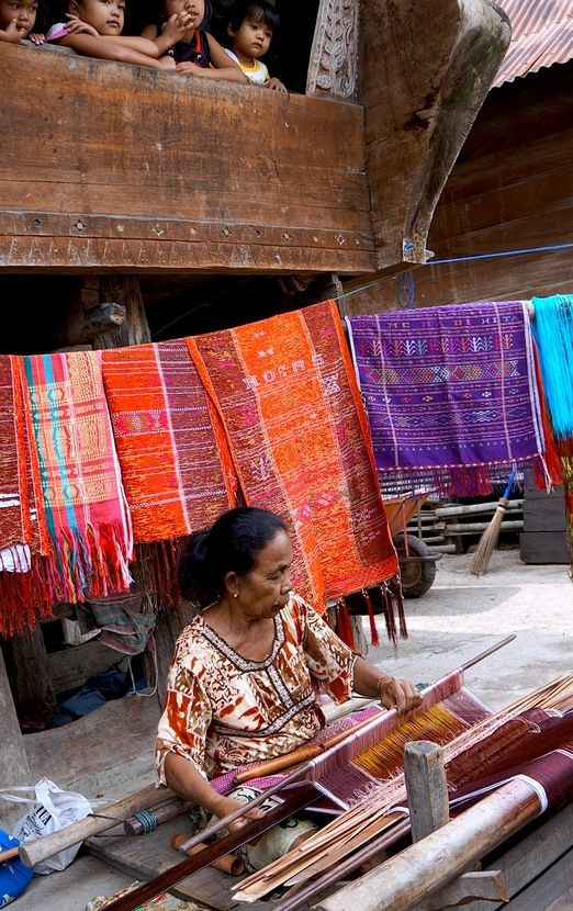 Woven in history: Weaving ulos in Lumban Suhi-suhi is a part of life for women in the village. (Photo by Edna Tarigan)