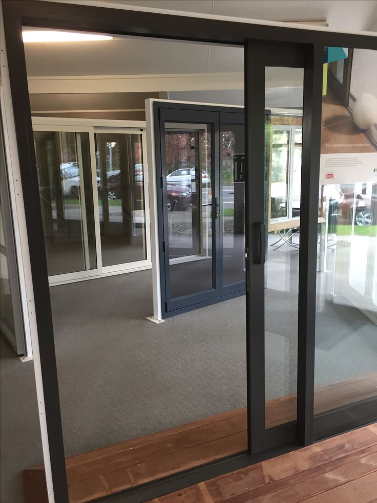 Sliding door - Standard in foreground (brown) Euroglide - finger tip control in background (cream) Costs 10% more