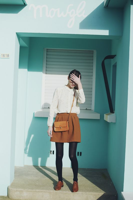 White shirt + brown skirt.