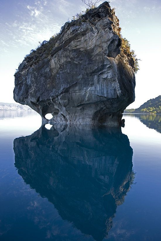 Rare calm on Lake General Carrera in Chilean Patagonia. For millennia, nature has formed this cave and exposed the hard marble.