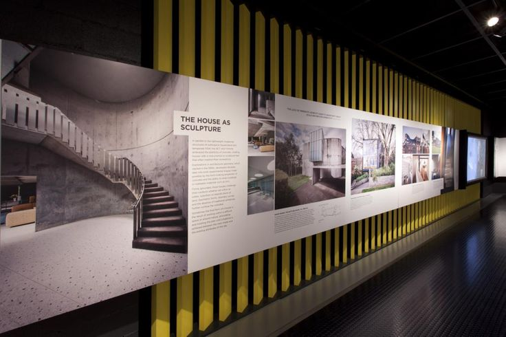 This is a photograph of a strip of exhibition panels with colour photographs applied along one wall