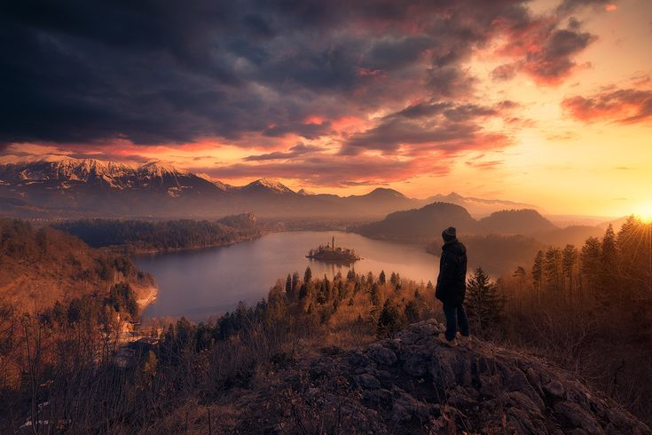 The world beneath - You have already seen the long exposure version of this one. But this seems to be better than the previous one to me. I was looking at this place as I am going here soon and found this one. An remarkable sunrise over Lake Bled. This was taken just when the sun started to show. I already said the addition of the human element to the composition was inspired from my favourite photographer out there i.e Max Rive. Enjoy :)