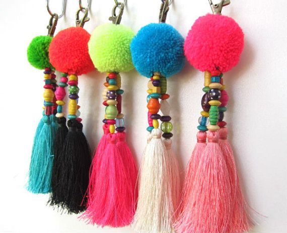 Luisa Tasselled Keychain Trio of Long Silky Tassels Large Handmade Wool Pom Pom Beadwork Bag Charm Trio Tassel Keyring Gift For Her Featuring handmade fluffy wool pom pom complete with wood and glass colored beadwork and a trio of 4 silky luxe tassels,complete with brass clasp. Total length approx 7 Please select your preferred combination from the list below and leave in the NOTE box after checkout 1. Lime Green Pom Turquoise tassels 2. Orange Pom Black tassels 3. Neon Yellow Pom Pink Ta...