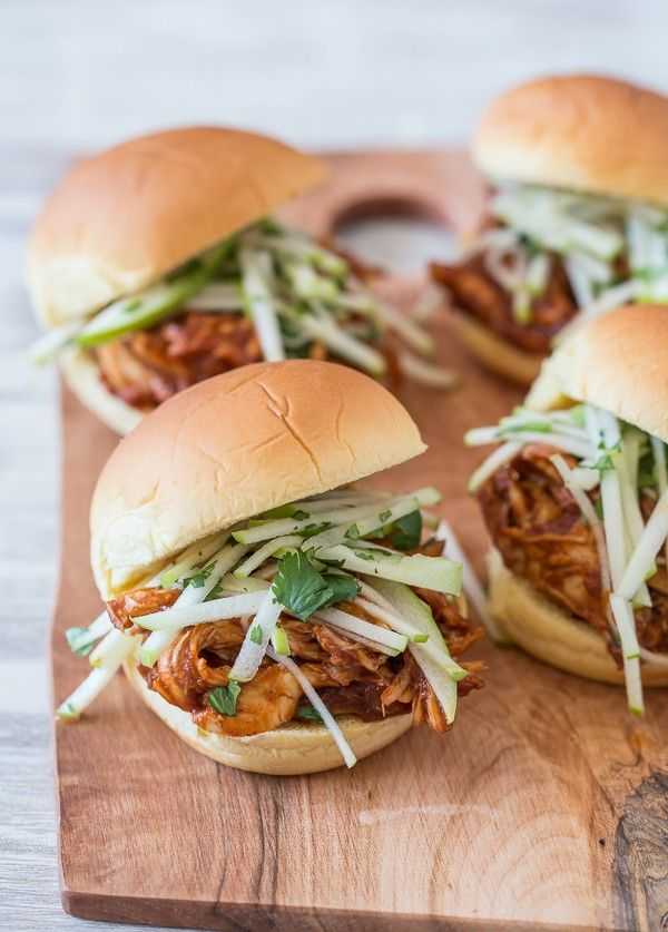 This apple butter bbq chicken sandwich is made with a homemade apple butter bbq sauce, roasted chicken breast and topped with a tangy tart apple cilantro slaw.