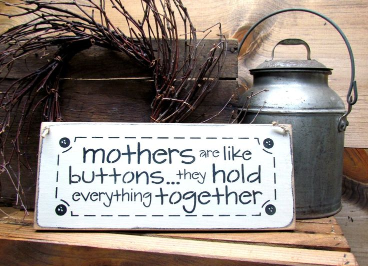 "What A Great Mother's Day Gift This wooden Mom sign is made from pine, and measures Approx 5.5""W x 13""L. It reads "" Mothers Are Like Buttons They Hold Everything Together"". The front is painted Craft"