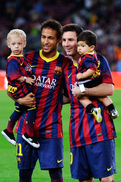 Neymar of FC Barcelona with his son Davi Lucca (L) and his team-mate Lionel Messi of FC Barcelona with his son Thiago pose for a photo prior to the La Liga match between FC Barcelona and Real Sociedad de Futbol at Camp Nou on September 24, 2013 in Barcelona, Catalonia.