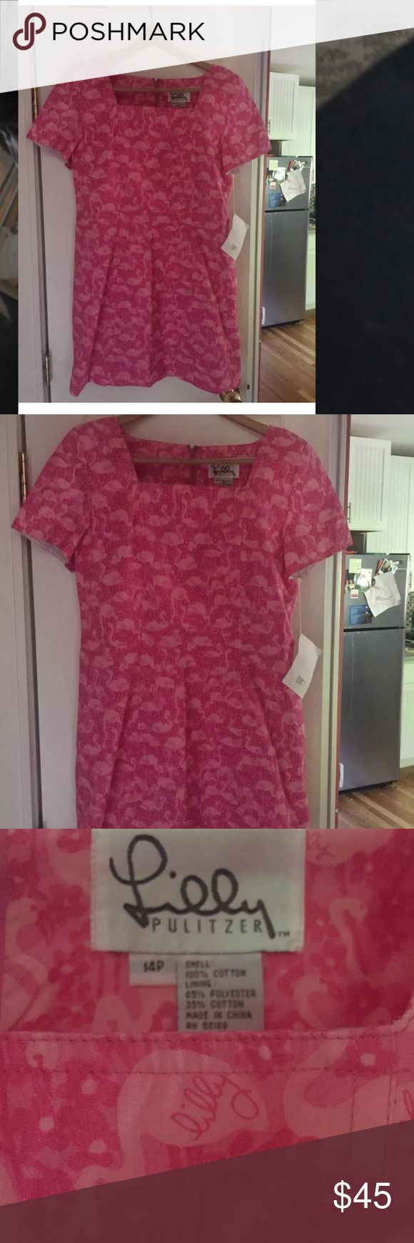 Lilly Pulitzer size 14 petite pink dress. Size 14p pink dress. The outer layer is made of 100 % cotton and the lining is 65% polyester and 35% cotton. It has flowers and flamingoes on it Lilly Pulitzer Dresses Mini