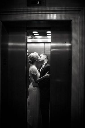 Wedding couple kissing in elevator | photography by http://www.jadeandmatthew.com/