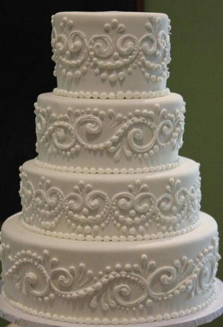 Add a couple of light pink flowers here and there and this cake becomes my dream wedding cake!