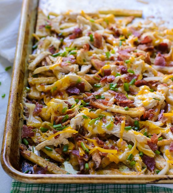 Chicken Bacon Ranch Fries Recipe with bacon, russet potatoes, olive oil, garlic powder, onion powder, dried dill, kosher salt, cayenne pepper, cooked chicken, ranch dip, sharp cheddar cheese, mozzarella cheese, chives