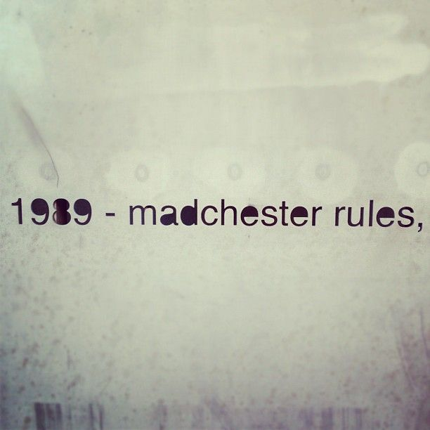 Madchester rules - engraved words on the side of the old Hacienda, Manchester.