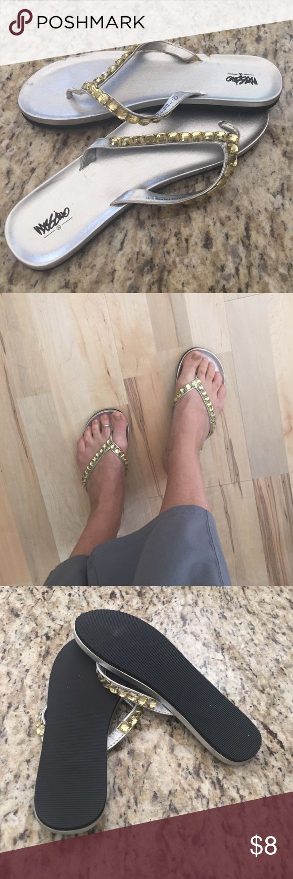 Gold jewel & silver flip flops Cute silver flip flop sandal with gold/yellow tone embellishment. This is a reposh..they are just a little snug on me. 😕 I'm usually a 7.5 but sometimes 7 flops fit me but these are a little snug on me. Size 7. Mossimo Supply Co. Shoes Sandals