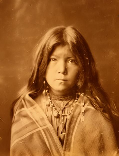 "Apache Indian Girl    You are viewing an original photograph of an Apache Indian Girl. The photo is by Curtis, and was taken in 1903. Curtis captioned the image, ""Apache Youth""    More Apache Indian Pictures"