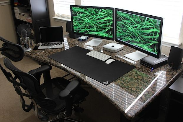 "Gorgeous granite desk setup with a Mac Mini driving dual Thunderbolt 27"" Displays and a MacBook Pro Retina:"