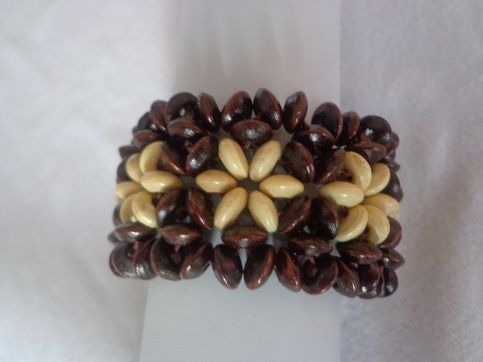 variety of ethnic designs and colors of wooden bracelets.     made in china, approximately 7.5 inches
