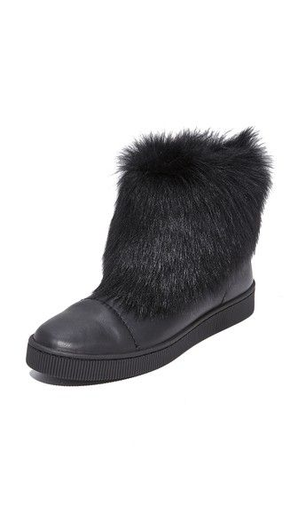 Get this PEDRO GARCÍA's platform booties now! Click for more details. Worldwide shipping. Pedro Garcia Priya Shearling Booties: Plush shearling trims the slouchy, fold-over cuff on these soft leather Pedro Garcia booties. A ridged, tonal platform adds a sporty touch. Rubber sole. Fur: Dyed lamb shearling, from Spain. Made in Spain. This item cannot be gift-boxed. Measurements Shaft: 8.75in / 22cm (botines de plataforma, plataformas, platform, stiefeletten mit plateau, botines de plataforma…