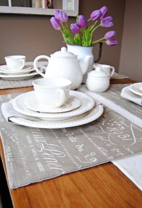 love these placemats! (not to mention the purple tulips) :)