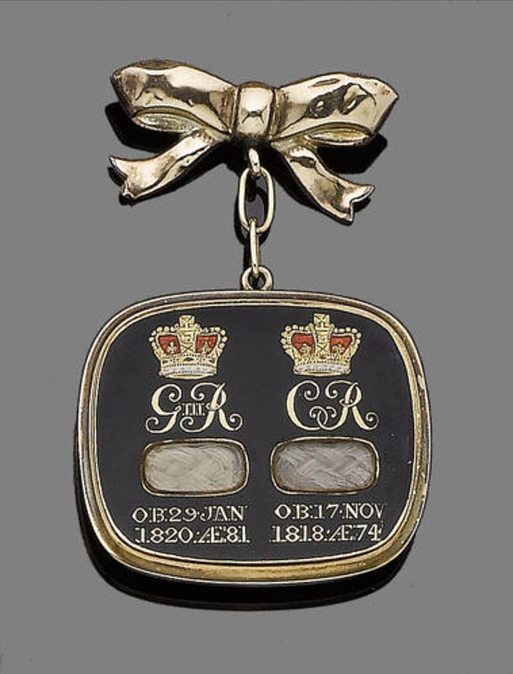 "A mourning plaque, circa 1820s The gold-bordered black enamelled plaque, with ciphers and obituary dates for George III and Queen Charlotte, two enamelled crowns and two plaited hair compartments, the reverse engraved ""Lord Byron"" above crossed laurel leaves, later bow brooch fitting, dimensions 5.3cm x 3.7cm"