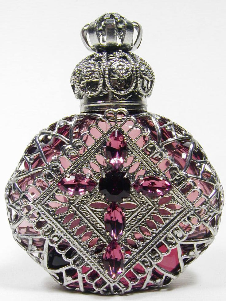 Jeweled Perfume Bottles. So fancy. I´d want a special unique scent for this bottle. Like bvlgari