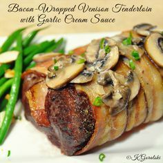 This is a very tasty, tender, juicy and flavorful way to cook venison! Yum. My avid hunter husband enjoyed this. Bacon-Wrapped Venison Tenderloin with Garlic Cream Sauce #venison #bacon