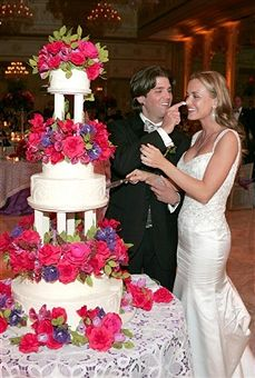 Newlyweds Donald Trump Jr. and Vanessa Trump cut a slice of wedding cake at their wedding reception at The Mar-a-Lago Club November 12, 2005 in Palm Beach, Florida.
