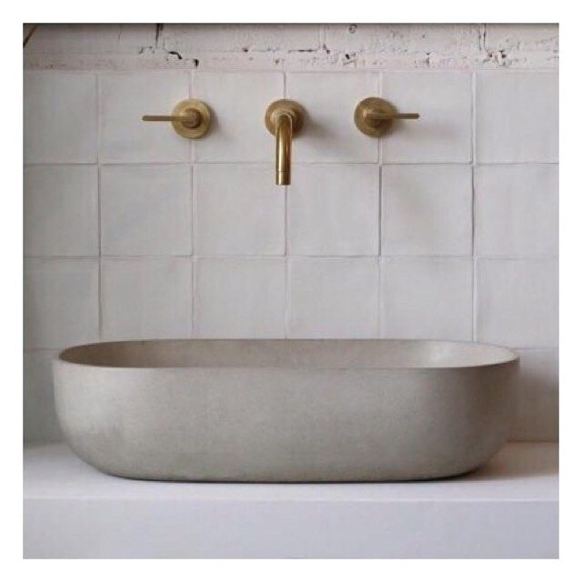 These wall mounted brass tap and elegant curved concrete basin are from @bertandmay ⠀ #entertheloft #bathroom #sink #basin #tapware #interior #inspiration #brass #concrete