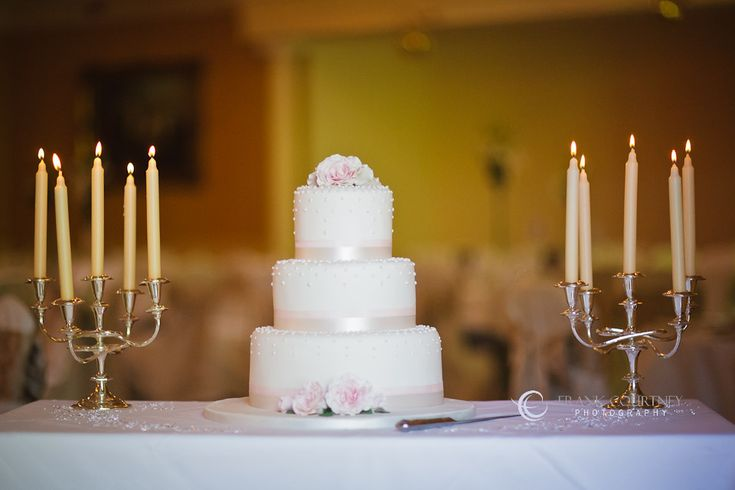 Wedding cake with candles on both sides