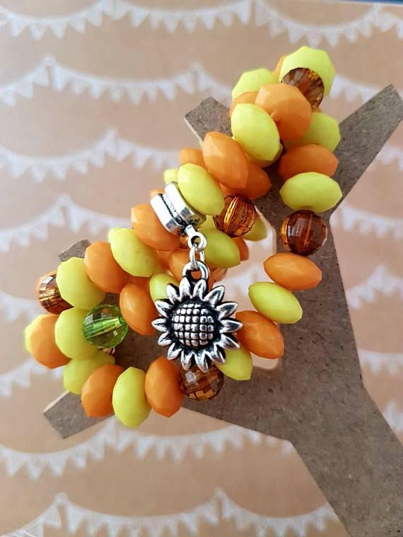 Check out this item in my Etsy shop https://www.etsy.com/au/listing/551070100/yellow-sunflower-beaded-bracelet