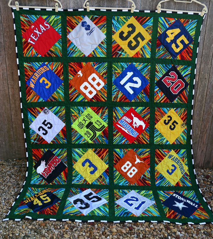 T-shirt quilt made from a 5th graders sports jerseys.  Quilting lines are the seating chart at Dallas Cowboys Stadium.