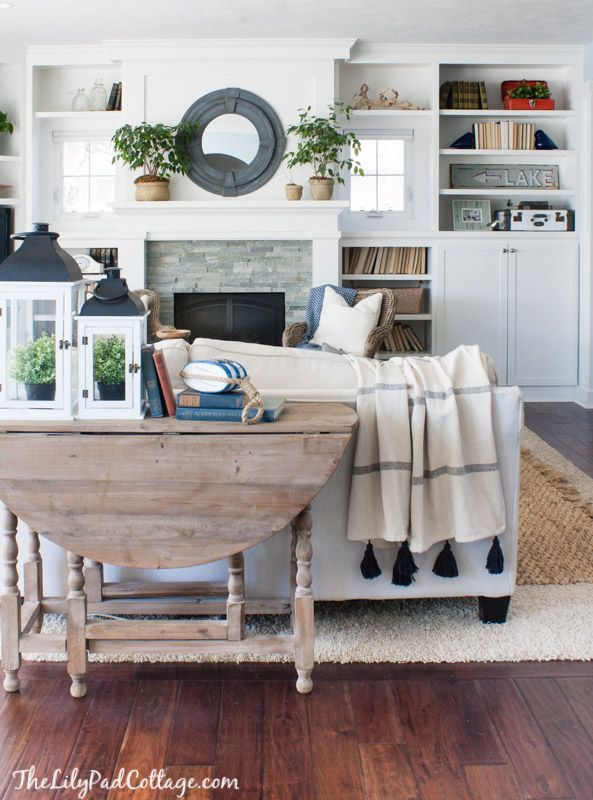 Lake House Living Room Decor with layered rugs by The Lilypad Cottage
