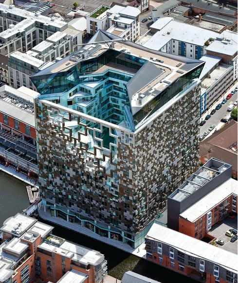 The Cube - Birmingham, England;  a 25 story mixed-use building, including offices, shops, hotel, a skyline restaurant, and apartments;  holes punctured through The Cube's 'skeleton' allows light in the central core;  designed by Ken Shuttleworth of MAKE Architects