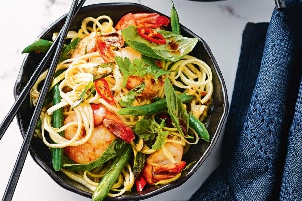 Turn zucchini into 'noodles' in this fresh, light stir-fry that will bring even the fussy eaters to the table.