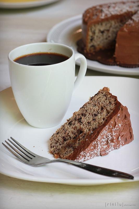 A cup of joe with a slice of Lemon Choco Cake - The Bake Bits