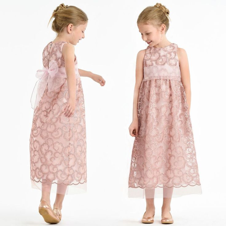 This beautifully embroidered dress from I Pinco Pallino, is hand crafted in Italy, with metallic sequins in rose gold and delicate gold thread in an ornate pattern. This ballerina length design has a chiffon sash, tulle petticoat, a cotton lining and concealed back zip fastening.   Model: Height 123 cm (average age 7) Size of dress worn in the photo: 6 years
