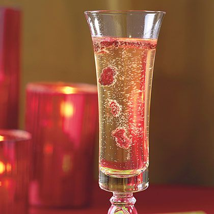 Champagne and Cranberries  Serve guests a tall, bubbling flute of champagne or your favorite sparkling wine and let the toasting begin. To the host! To the appetizers! To the neighbors! (Yes, they may overhear.) A colorful cranberry garnish adds a tart bite to the cocktail, as well as fun presentation.