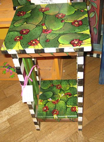 Handpainted cactus table - 24′ x 12′ handpainted side table with shelf by local artist Sharon Anderson
