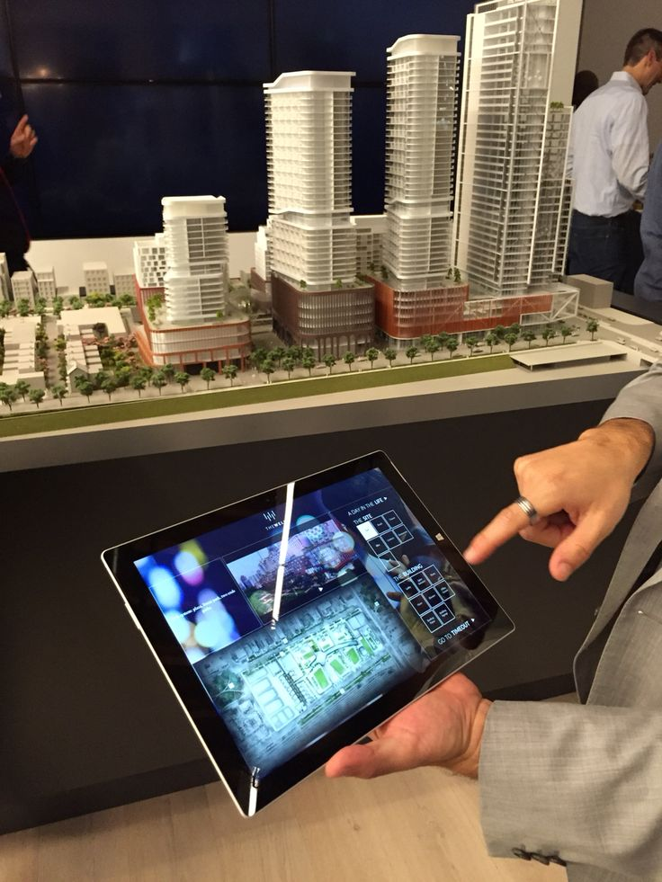 Interactive systems for condo sales centre. Surface pro computer controlling live model.