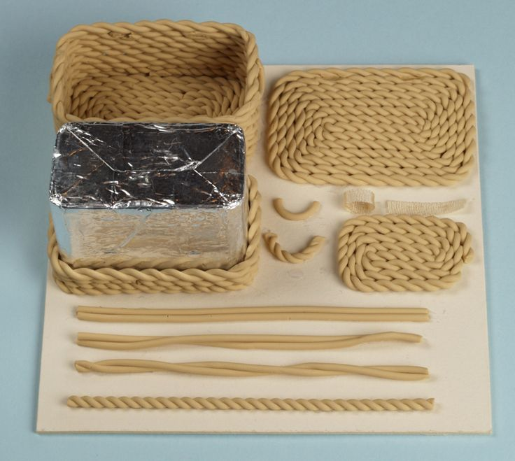This site is for making polymer clay projects, but I thought it would be a grand idea to make mini baskets like this using twine or rope with tin cans - bjl