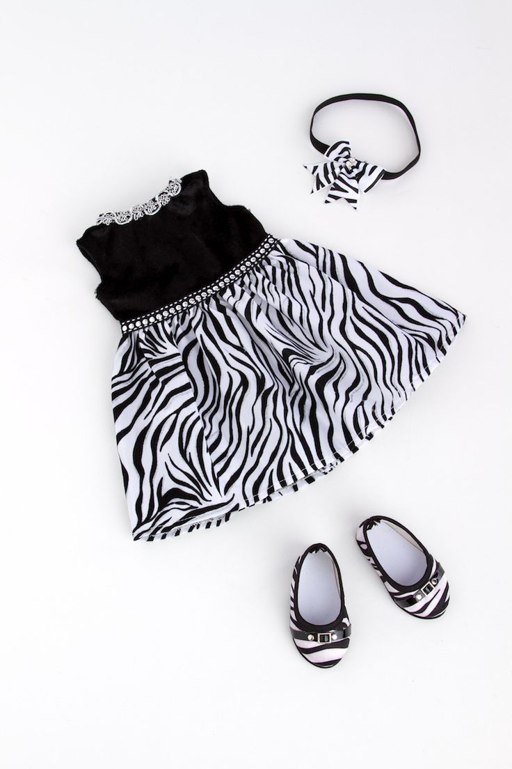 Have a little wild fun in this sparkling zebra dress with black top, head bow, and matching shoes. - Party doll dress contains a wide back closure for easy dressing and clothing removal. - Our doll cl
