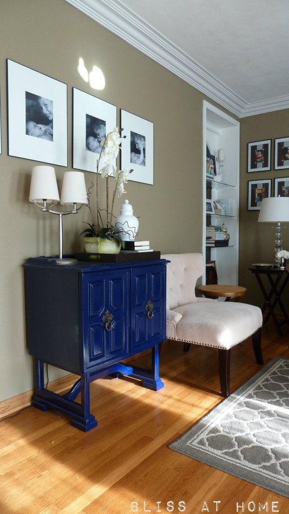 Deep blue cabinet is a striking accessory to this traditional Living Room - taupe walls make a superb backdrop.