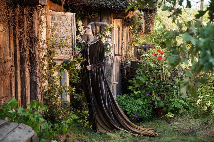 Maleficent (Angelina Jolie) outside Aurora's cottage