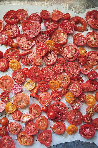 DIY sun-dried tomatoes. Add some olive oil & seasoning if you like. Heat in oven at a low setting: 100c for ~ 6 or 7 hours. Make sure they are completely dry if you want to store them. Store in the fridge.