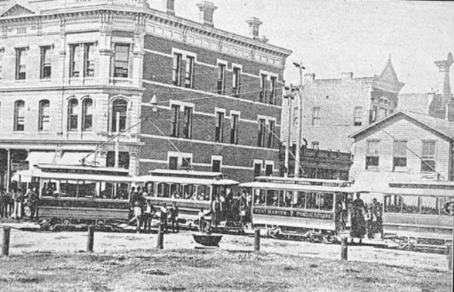 Streetcars at the corner of Washington and 4th Sts. in downtown Marion Indiana. Left rear building is Jason Willson's bank which was later torn down to make way for the Marion National Bank circa 1892