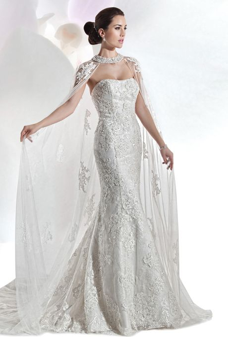 Brides: Demetrios - Ultra Sophisticates. Beaded lace, strapless fit and flare gown with a soft scoop neckline, and attached chapel train. Lace cape, with jeweling sold separately.