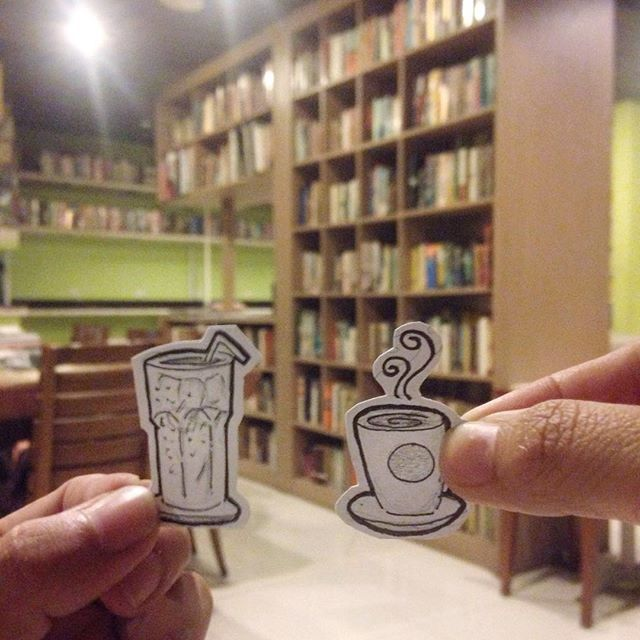 He likes his coffee cold, she likes her coffee hot. No matter their differences, Abang & Neng like enjoying their cups of coffee in each other's presence.  Location: Reading Room, Kemang.  #instadaily #coffee #cafe #cafehopping #thereadingroom #books #cappucinno #latte #couple #doodles #library #coffeelover #coffeetime #instamoment #instago #instapic