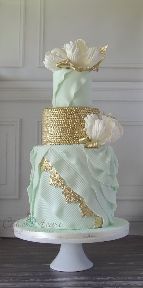 Soft mint ribbed layers with gold accents and 'sequins', along with stylized tulips