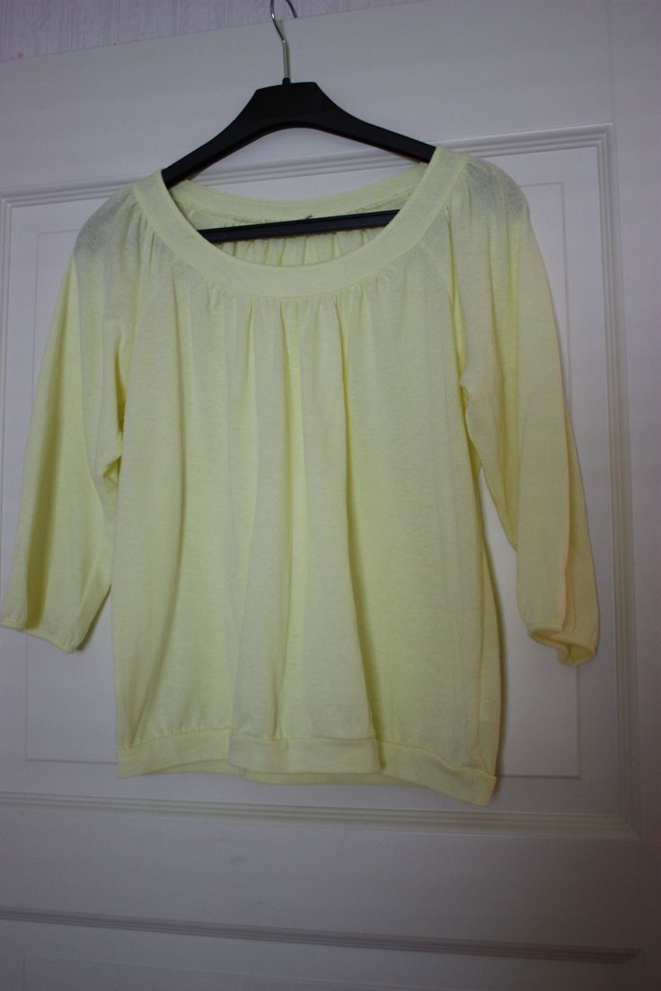 Shirt light yellow 3/4 sleeves, a bit transparent